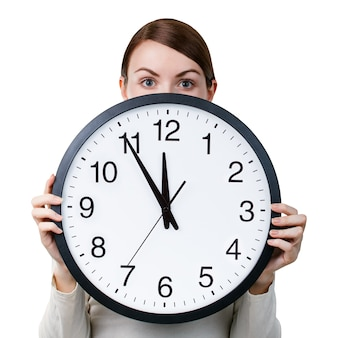 Woman with an office clock isolated on a white background