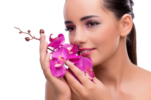 Woman with orchid flower isolated on white