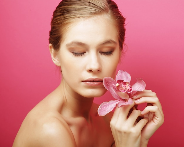 Woman with orchid flower