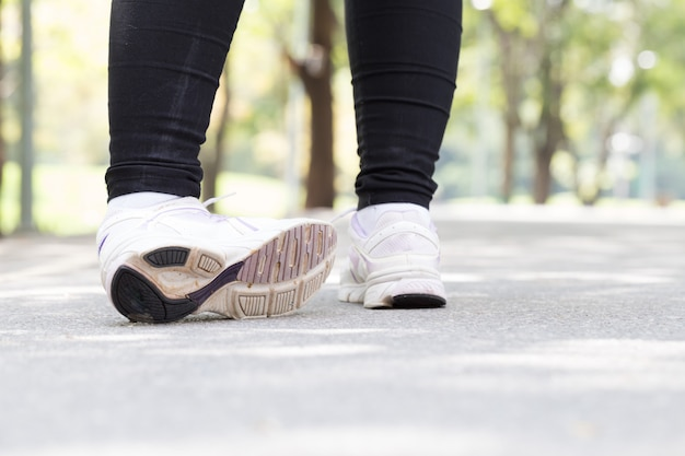 Woman with pain in ankle while jogging