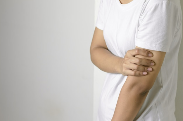 Woman with pain in arm.
