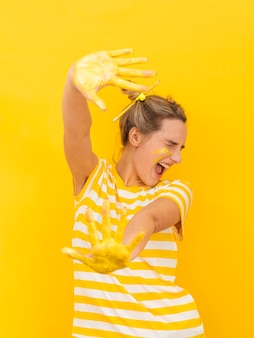 Woman with painted hands being scared