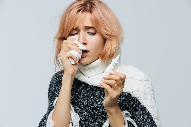 Woman with paper napkin sneezing