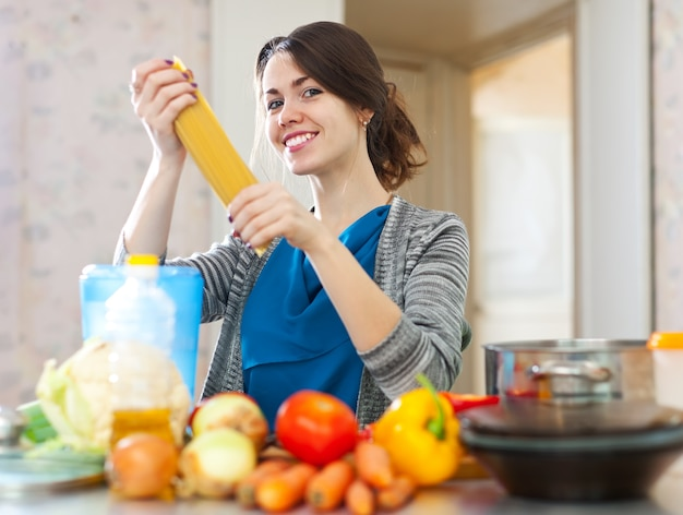 Woman with pasta and vegetables