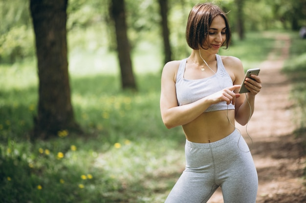 Woman with phone in sportswear