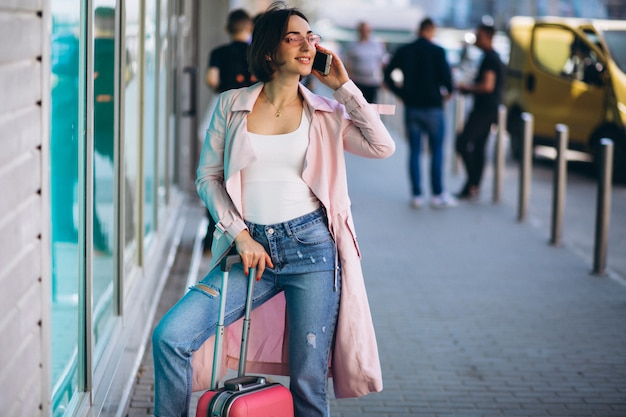 Woman with phone travelling