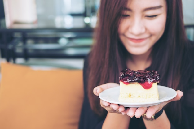 Woman with a piece of blueberry cheese cake