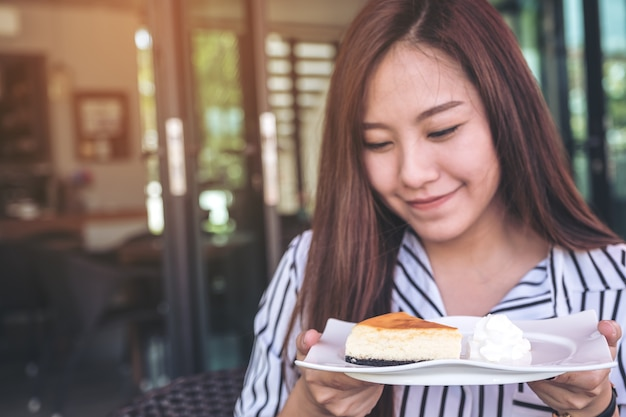 Woman with a piece of cheese cake dessert