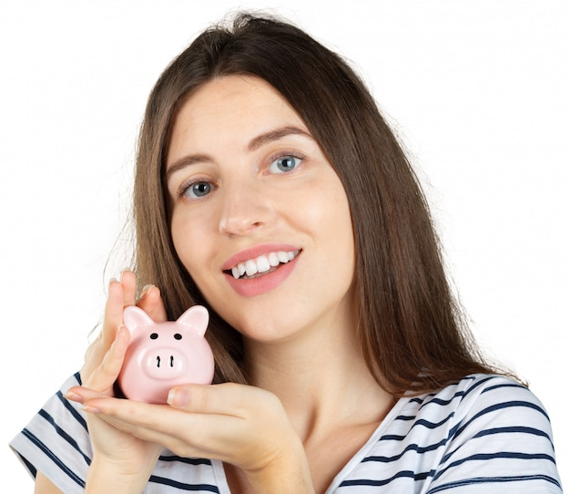 Woman with a piggy bank. isolated over white
