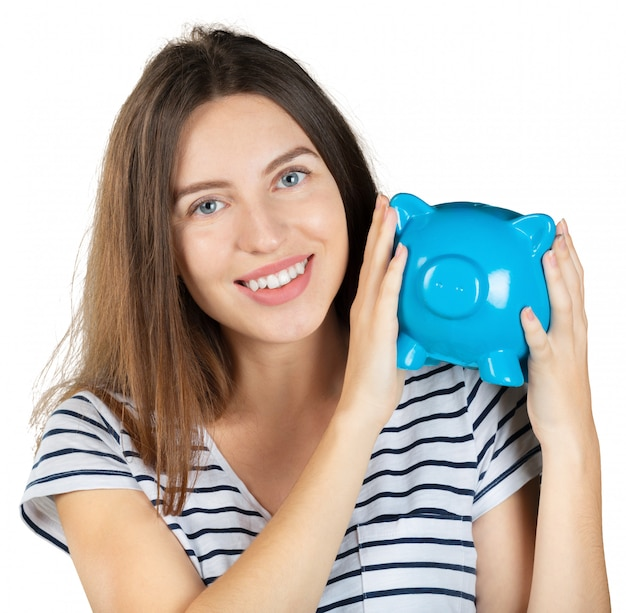 Woman with a piggy bank. isolated