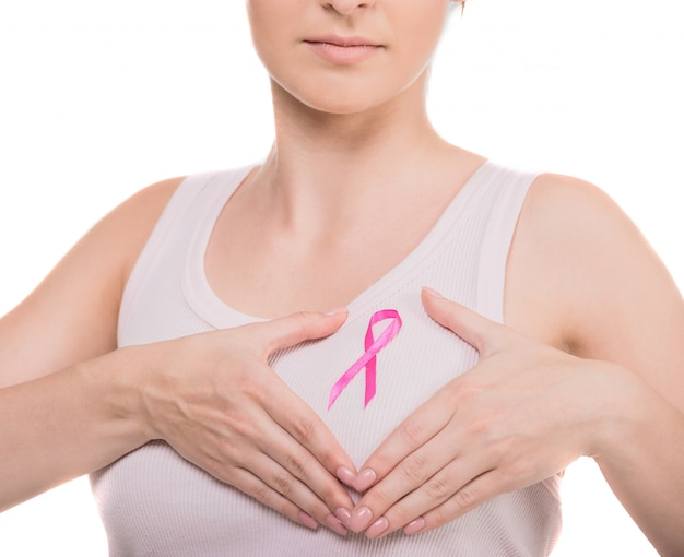 Woman with pink breast cancer awareness ribbon.