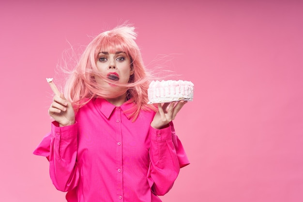 Woman with pink hair brownie holding sweets candy