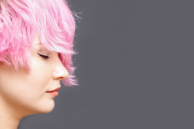 Woman with pink hairstyle close up
