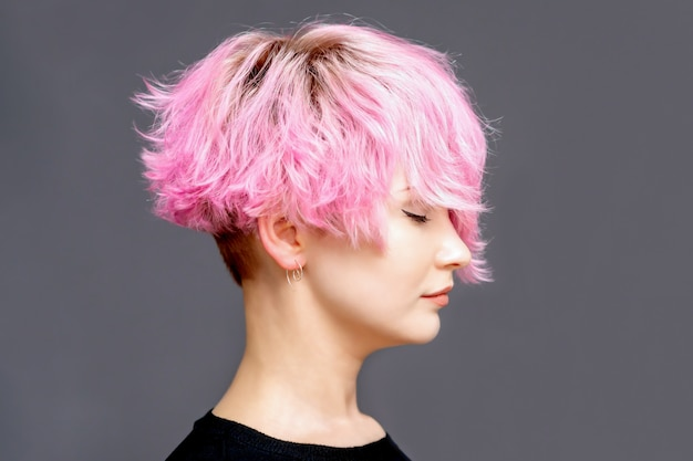 Woman with pink hairstyle.