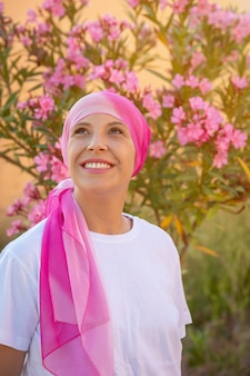 Woman with pink scarf on the head