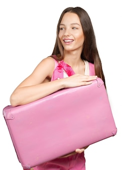 Woman with pink suitcase