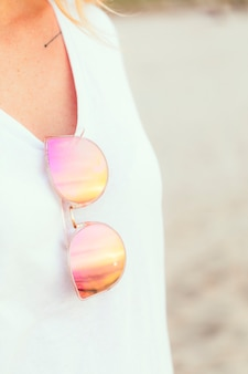 Woman with pink sunglasses at the beach