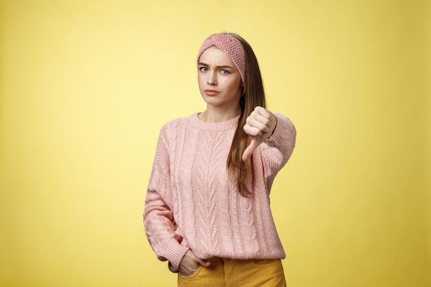 Woman with pink sweater over yellow
