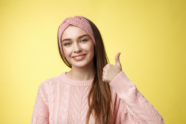 Woman with a pink sweater over yellow