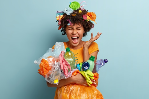 Woman with plastic waste in net bag