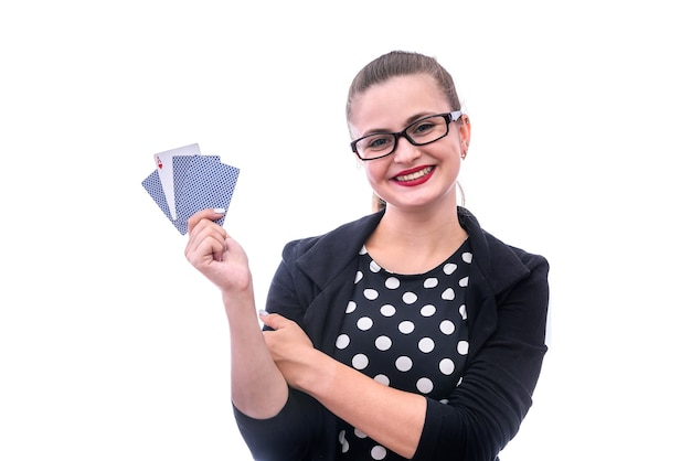 Woman with playing cards isolated on white
