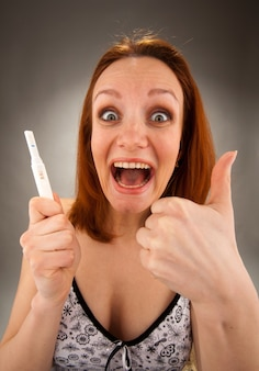 Woman with pregnancy test