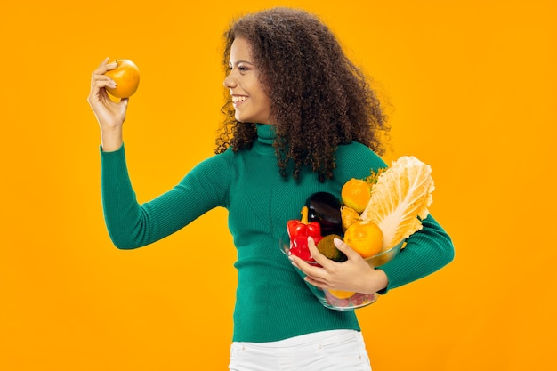 Woman with products in hand on a yellow
