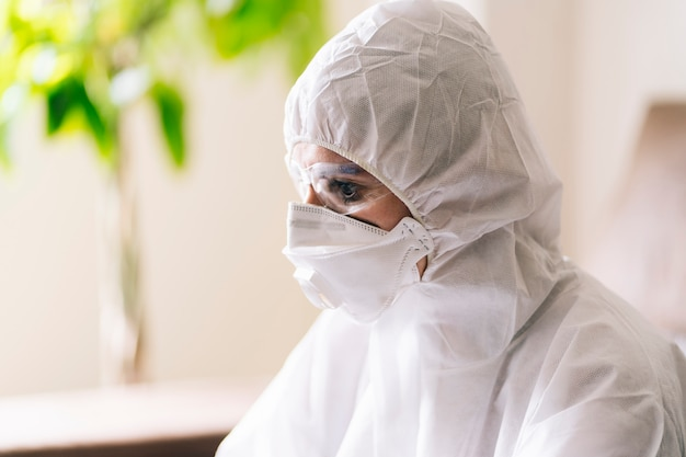 A woman with protection against a pandemic or virus wearing a mask and glasses