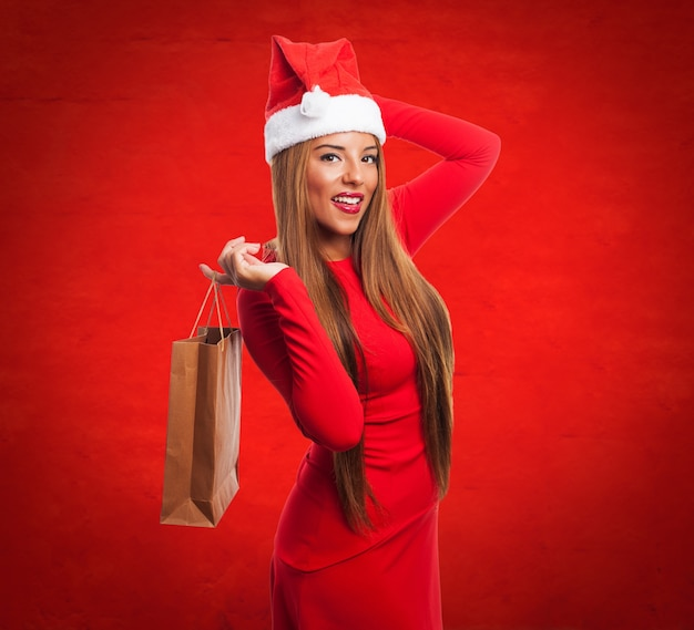 Woman with a purchase bag in a red background