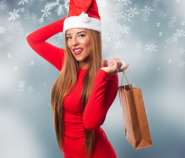 Woman with a purchase bag in snowflakes background