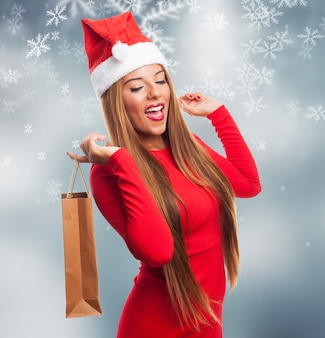 Woman with a purchase bag in a snowflakes background