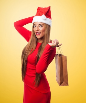 Woman with a purchase bag in a yellow background