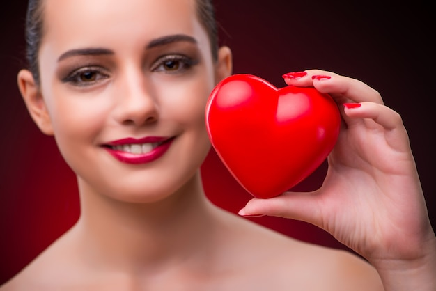 Woman with red heart in romantic