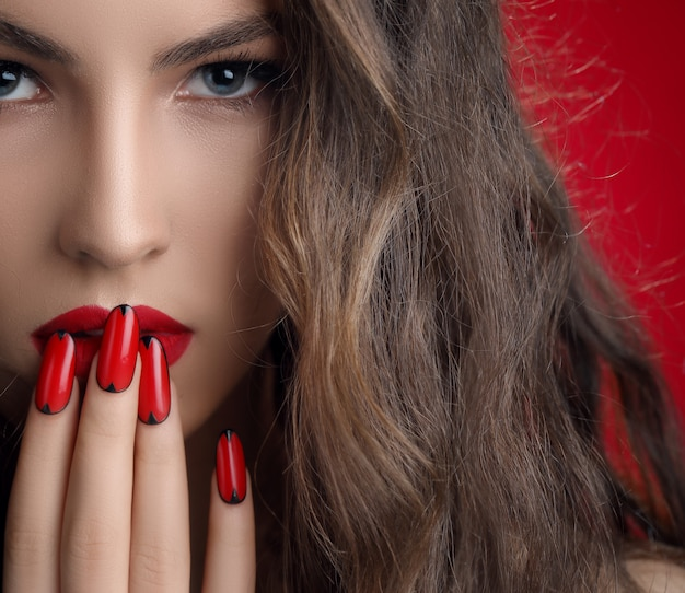 Woman with red manicured nails