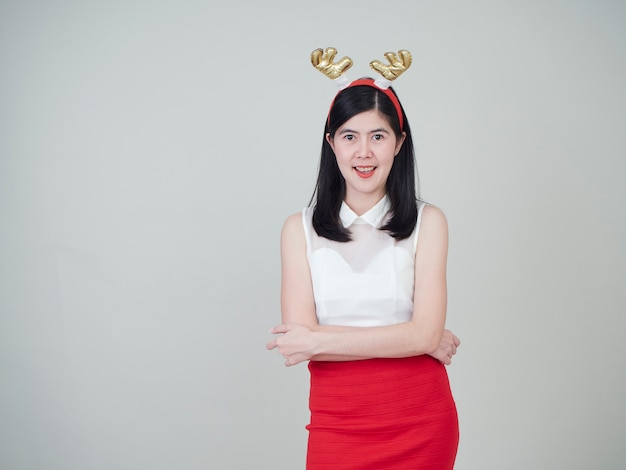 Woman with reindeer headband in christmas day.