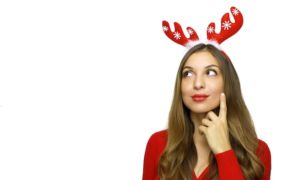 Woman with reindeer horns thinking isolated