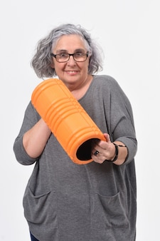 Woman with roller foan on white