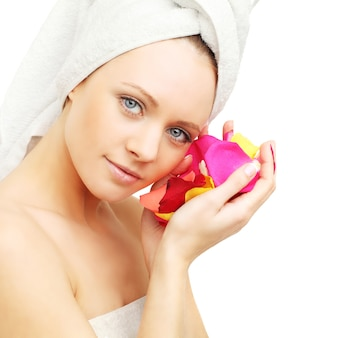 Woman with rose petals - skin care