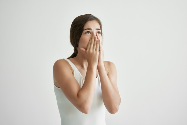 Woman with a runny nose wipes her nose with a handkerchief cold infection