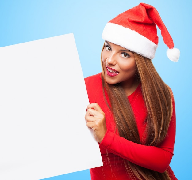 Woman with santa hat and holding a blank sign