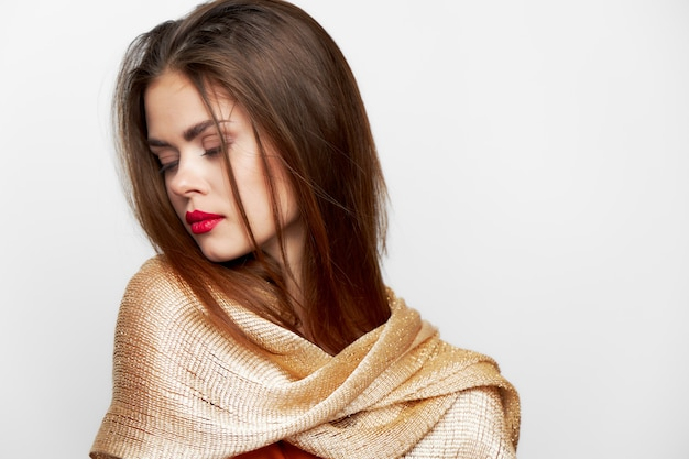 Woman with a scarf eyes closed