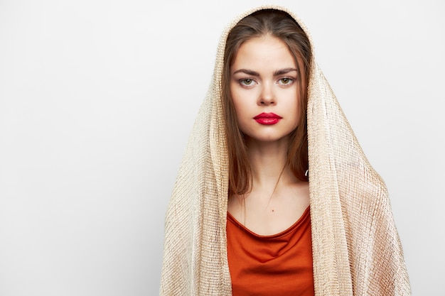 Woman with a scarf glamor red lips look ahead model with cosmetics on the face front view