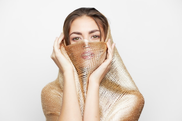 Woman with a scarf religion and ethnicity cover the face fashionable style isolated light space