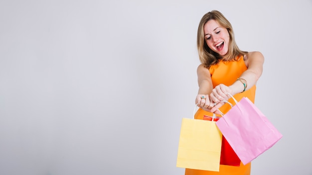 Woman with shopping bags and space on left
