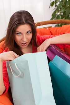 Woman with shopping bags surprised