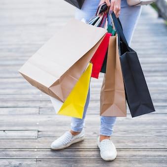Woman with shopping packets and smartphone