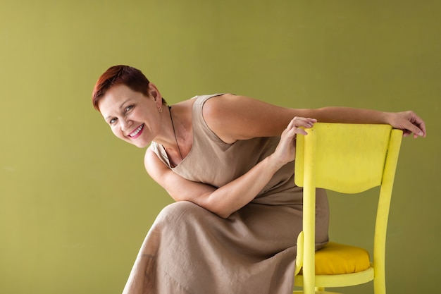 Woman with short hair sitting on chair