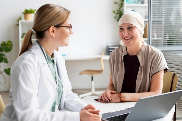Woman with skin cancer talking with the doctor