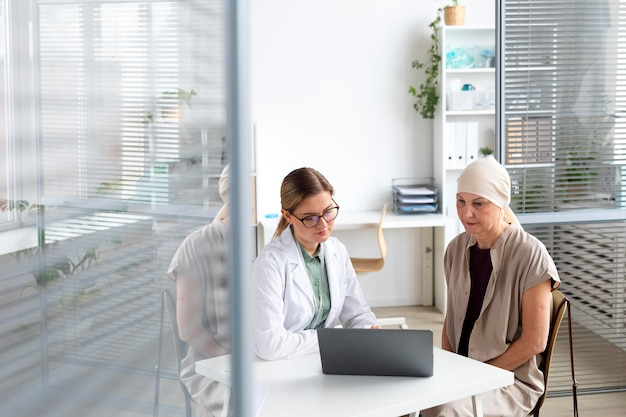 Woman with skin cancer talking with her doctor