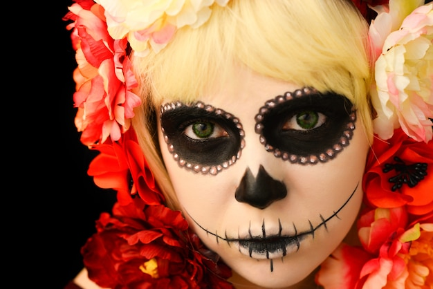 Woman with skull make-up and blond hair